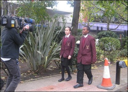 Hashim and Allae being filmed for Newsround