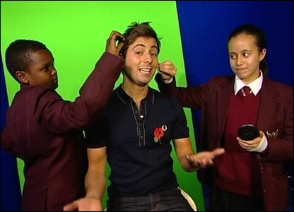 Hashim and Allae put special TV make up on Ricky.