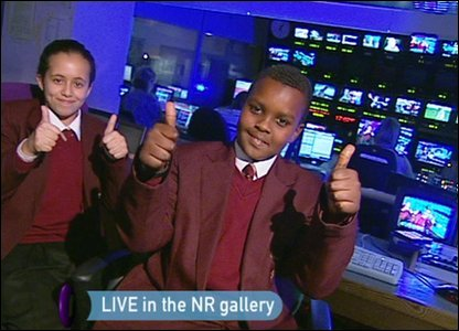 Hashim and Allae giving a thumbs up in the gallery.