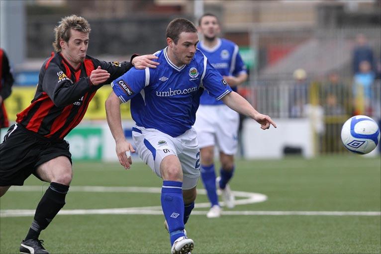 Aidan watson and jamie mulgrew pursue the ball during crusaders game