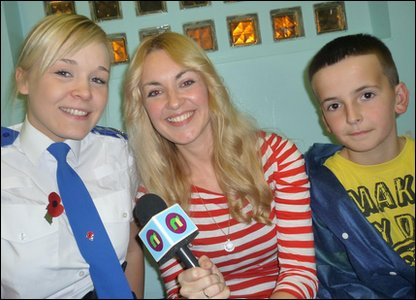 PCSO Mollie Jones with Newsround presenter Hayley Cutts, and Vincent Chick