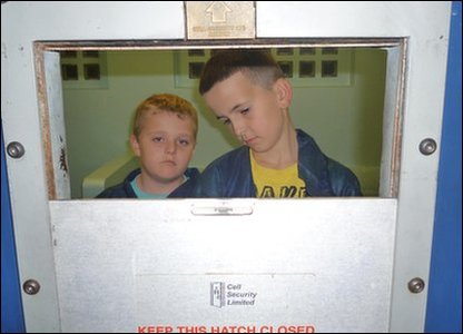 Vincent Chick (aged 12) and Ashley Gronow (aged 11) in their cell for the night.