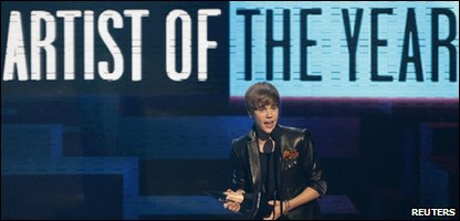 Justin Bieber picking up his award for artist of the year at the American Music Awards
