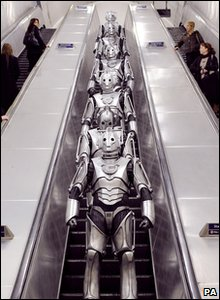 Cybermen in London: On a tube escalator