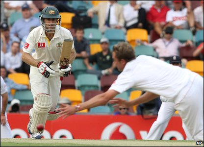 The Ashes 2010 first Test - Australia's Simon Katich bats the ball past England's Stuart Broad