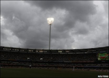 Dark clouds and rain stop play at the Gabba