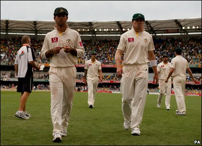 The Australian team leaving the pitch after the fourth day of the first Ashes Test match in Australia