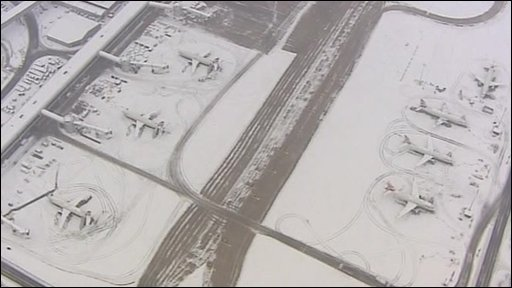 snowy planes at Gatwick airport
