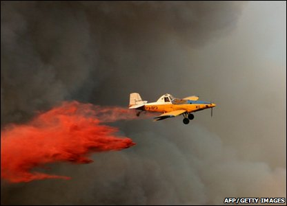An Israeli firefighter plane helps to extinguish raging fire in the Carmel Forest, near Israel's northern city of Haifa