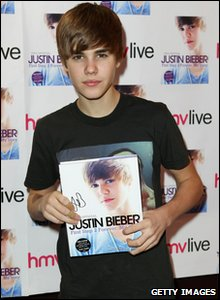 Justin Bieber with his new book, First Step 2 Forever: My Story, in London.