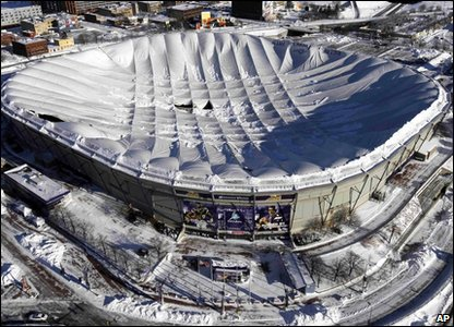 The Metrodome sports stadium in Minneapolis in America covered in snow.