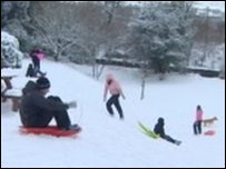 Kids sledging in the snow in Wales