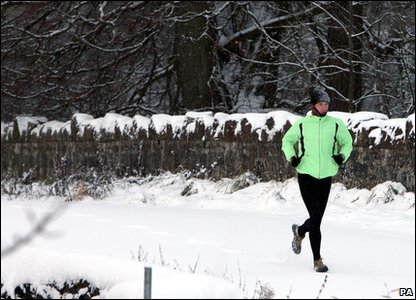 Man jogging in the snow in Country Antrim, Northern Ireland.