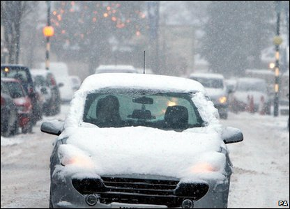 Car driving in the snow in County Antrim, Northern Ireland.