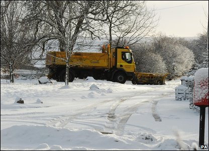 Snow plough working its way through the snow in  Northumberland in the north of England.