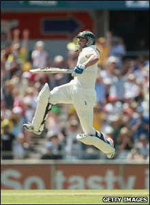 Mike Hussey jumps for joy after reaching 100 runs.