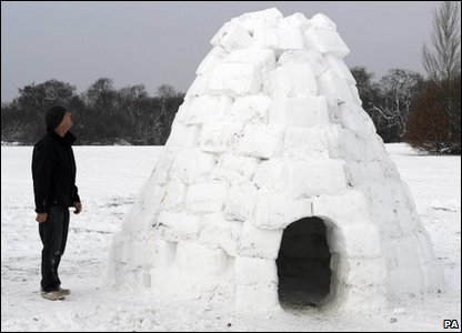 man with his igloo in the snow in London