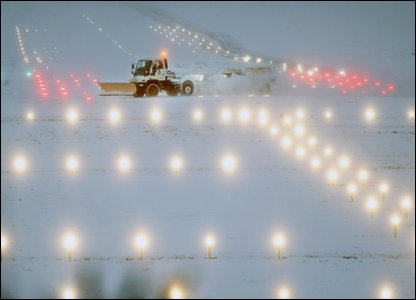 Snow being cleared from the runway at Heathrow airport