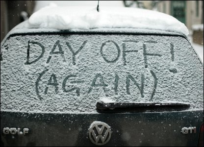 Day off written in the snow on a car