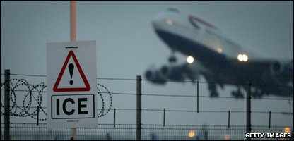 A plane taking off in the icy conditions at Heathrow