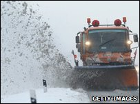A snowplough removes snow from an icy highway near Magdeburg, Germany