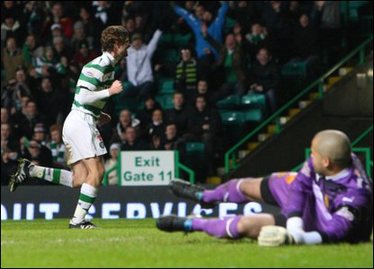 Celtic look to end 2010 at the top of the SPL after beating Motherwell 1-0 with a Paddy McCourt goal in the first half.
