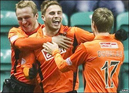 David Goodwillie celebrates after scoring both of Dundee United's goals against Hibernian. The final score was 2-2.