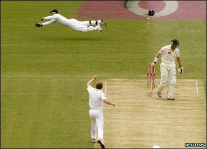 England's Paul Collingwood celebrates bowling out Australia's Michael Hussey.