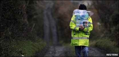 A man collects bottled water supplies at the height of the water crisis