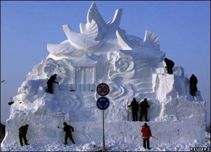 Sculpture and workers at the annual snow and ice festival in Harbin in China.