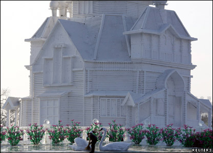 Sculpture of a house and two swans at the annual snow and ice festival in Harbin in China.