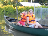 Mariah and her brother in a canoe