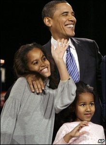 American President Barack Obama with his two daughters, Malia and Sasha