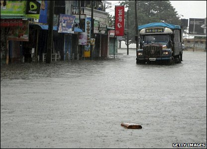 Flooding around the world - Sri Lanka - truck on flooded street in Batticaloa