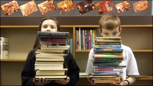 Kids help take out all the books at Stony Stratford Library in Milton Keynes in a bid to save it from closing