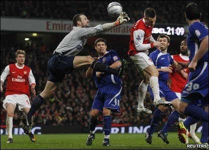Arsenal's Laurent Koscielny scores past Ipswich Town's keeper Marton Fulop