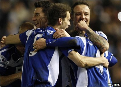 Birmingham City are through to the Carling Cup final after beating West Ham 4-3.