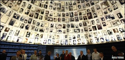 Visitors stand underneath pictures of Jews killed in the Holocaust during a visit to the Hall of Names at the Yad Vashem Holocaust History Museum in Jerusalem January 26, 2011