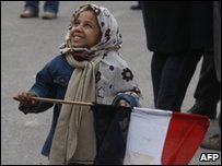 A child holds an Egyptian flag during the protests