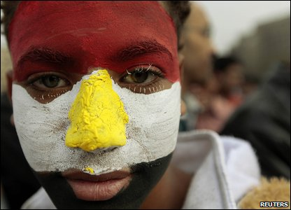 Demonstrator with his face painted with the Egyptian flag
