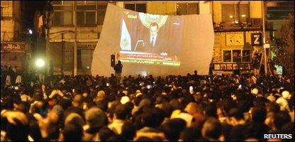 Protestors in Cairo's Tahrir Square watch President Hosni Mubarak's speech on TV