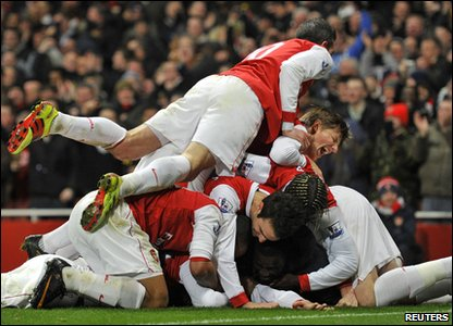 Arsenal v Everton - Arsenal players dive on top of Laurent Koscielny after he scored the winning goal