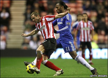 Sunderland v Chelsea - Phil Bardsley fights for the ball with Didier Drogba