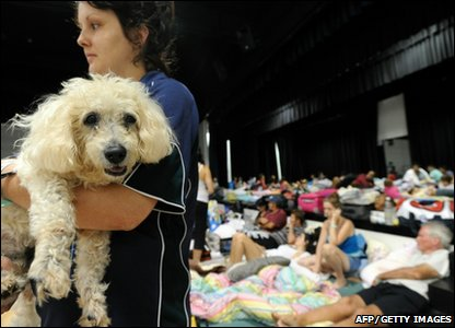 A woman with her dog, Scruffy, at an evacuation centre in Innifail