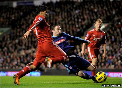 Liverpool v Stoke - Luis Suarez fights for the ball