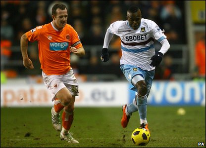 Blackpool v West Ham - West Ham's Victor Obinna and Blackpool's Charlie Adam battle for the ball
