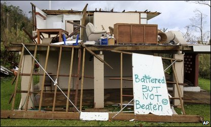 Cyclone Yasi clean-up - a homeowner in Tully in Australia shows their spirit