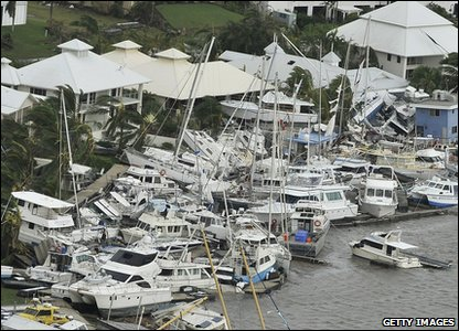 Cyclone Yasi aftermath in Queensland, Australia - boats crashed against Hinchinbrook harbour