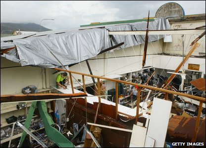 Cyclone Yasi aftermath in Queensland, Australia - business owner whose had part of his roof blown off in Tully