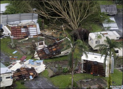 Cyclone Yasi aftermath in Queensland, Australia - overturned caravans and uprooted tree in Tully